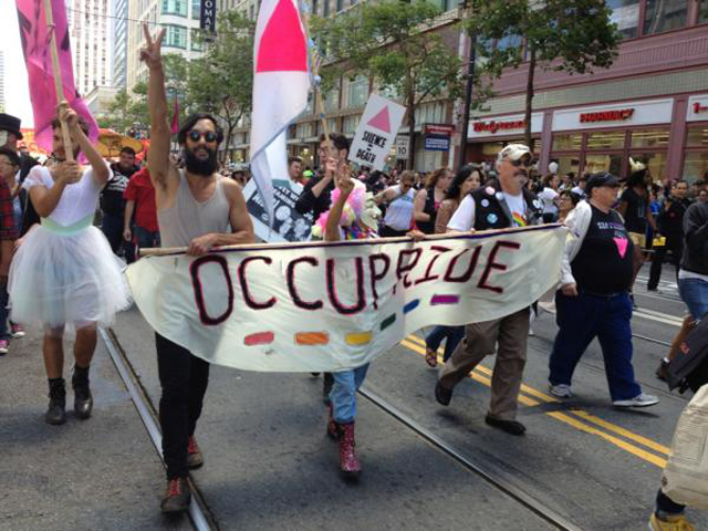 ... Gay Pride, temporarily blocked the San Francisco Gay Pride Parade today, ...